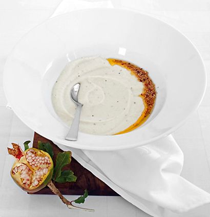 Garlicky creamed cauliflower soup with burnt mustard seed and chilli butter