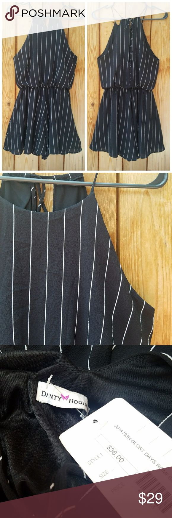 NWT Dainty Hooligan Black & White Pinstripe Romper Gorgeous! High neck, strap ties in back with a cute keyhole. 31 in long, Excellent condition  Feel free to ask me any additional questions! Bundles of 3+ items are 15% off. No trades, or modeling. Happy Poshing! Dainty Hooligan Pants Jumpsuits & Rompers