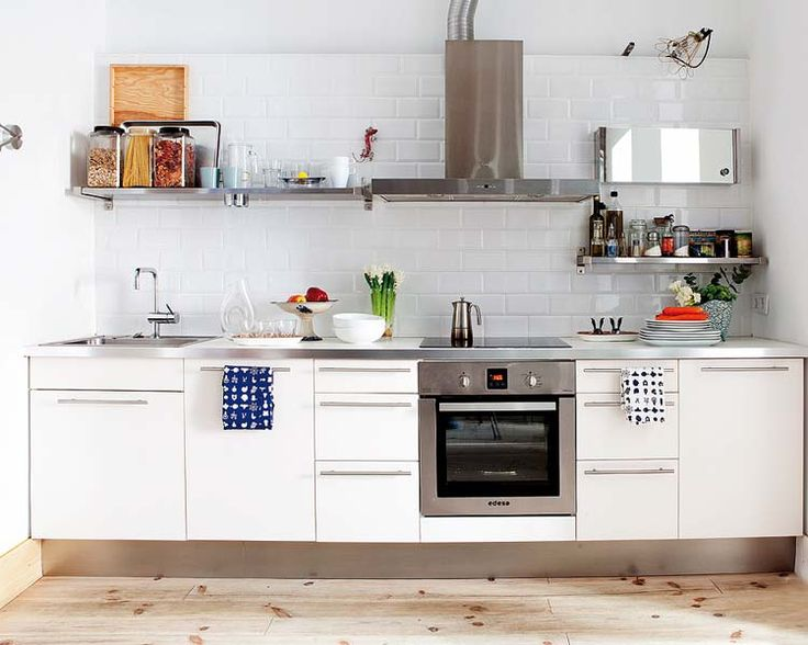 White. Subway tile. Open shelving. Small and simple kitchen