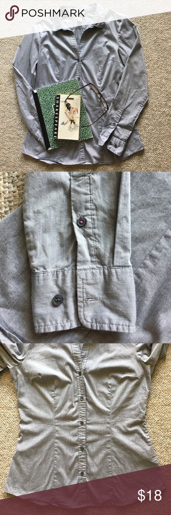Fitted Women's Button Up Fitted with darts to match a woman's curves. Light weight, classy slate grey color (possible blue hint). Professional but fashionable. I think my sister bought it while abroad in France (Euro size listed first on tag) . H&M brand.  Good as new, I will steam again before mailing H&M Tops Button Down Shirts