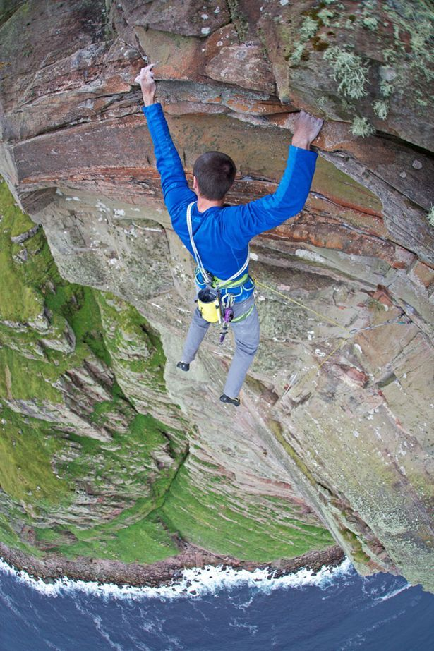 Dave MacLeod becomes first person to free-climb 1,000ft high St John's head on the Isle of Hoy in Scotland. Vertigo?