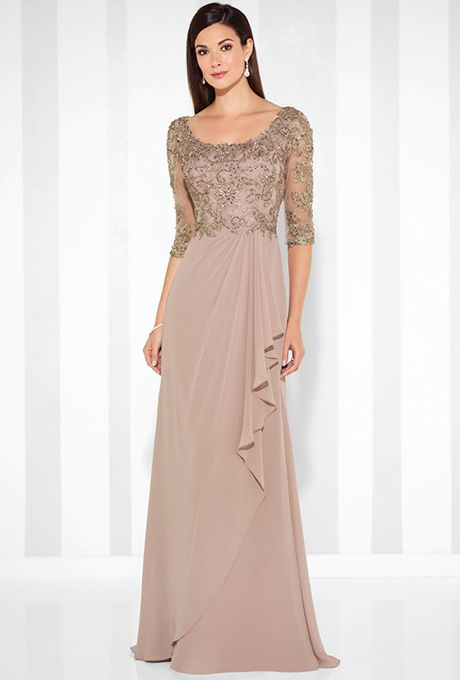 Cameron Blake. Chiffon A-line gown with hand-beaded lace illusion three-quarter length sleeves, front and back scoop necklines, beaded lace bodice, side draped skirt with cascading ruffle and center back gathers, sweep train. Available in blue color.