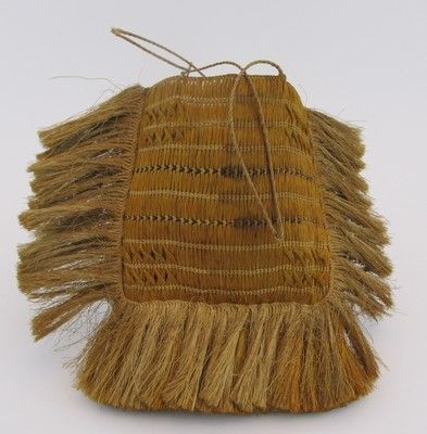 Kete, square shaped with a fringe on the side and bottom. ; 1880-1890…