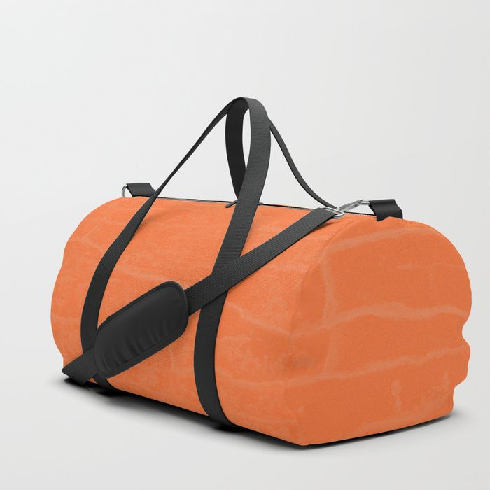 #juliusmarc #orange #dufflebag . Your new favorite gym and travel bags feature crisp printed designs on durable poly poplin canvas. Constructed with premium details for ultimate comfort. Available in three sizes.     - Durable poly poplin, canvas-like exterior   - Soft polyester lining with interior zip pocket   - Adjustable shoulder strap with foam pad and carrying handles   - Double zipper pull tabs for easy open/close   - Brushed nickel metal hardware