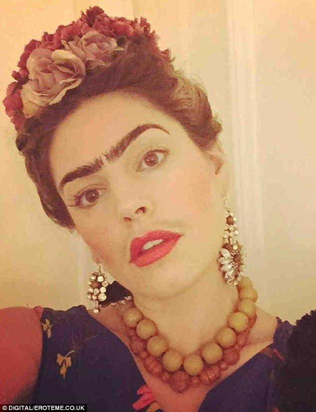 Unusual costume: Kelly Brook decided to dress up as late Mexican artist Frida Kahlo for Ha...