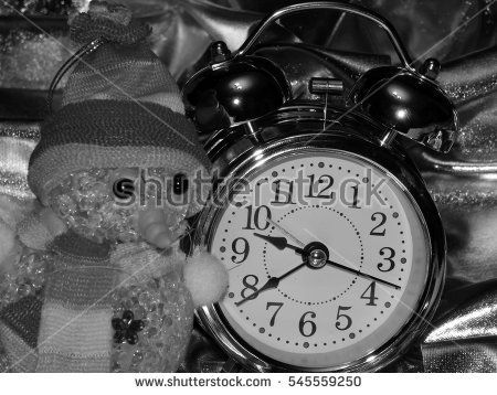 Christmas toy with a snowman and an alarm clock on a black and white image