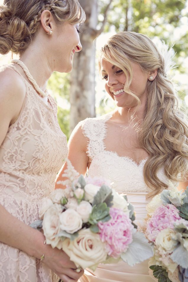 Love the hairstyle and the bouquet. Featured Wedding Flower: Camellia Wedding Flowers; Featured Photographer: Rebecca Joelson