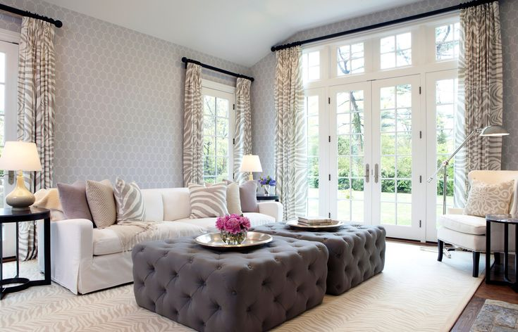 Slipcovers over light-coloured items; ottomans as coffee table