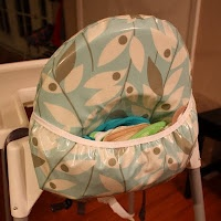 Ikea Antilop high chair cover with pocket. Wish I had a pocket on my highchair for bibs.