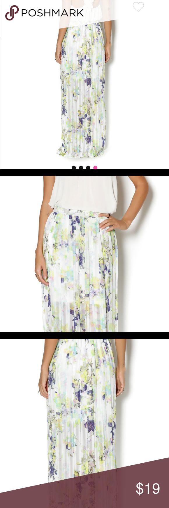 BCBGeneration whisper white multi Maxi Skirt Bedecked with a fluoro-bright Digi Bloom print, this pleated maxi looks fresh with this season's nubby sweaters or a silky cami. BCBGeneration Skirts Maxi