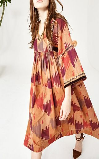 This **Ulla Johnson** dress features a sheath silhouette with a v-neckline and a midi length hem.