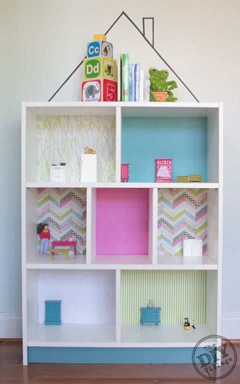 Give Your Kiddo a DIY Dollhouse. Use the Billy Bookcase from Ikea and line each section with different paper