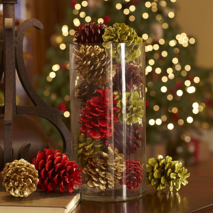 Fill a hurricane with pine cones - christmas mantel decorations or table top decor: