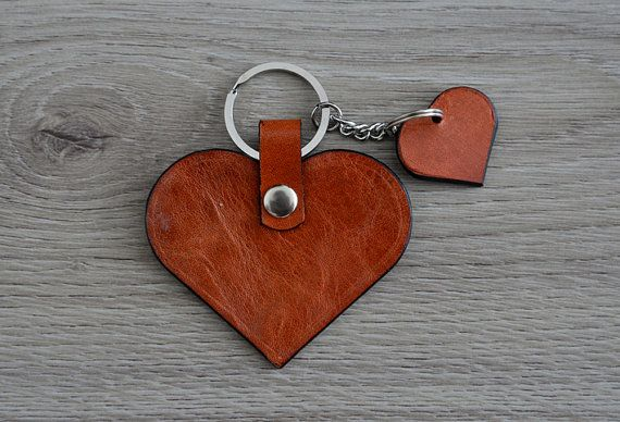 Hey, I found this really awesome Etsy listing at https://www.etsy.com/listing/231825213/leather-heart-keychain-brown