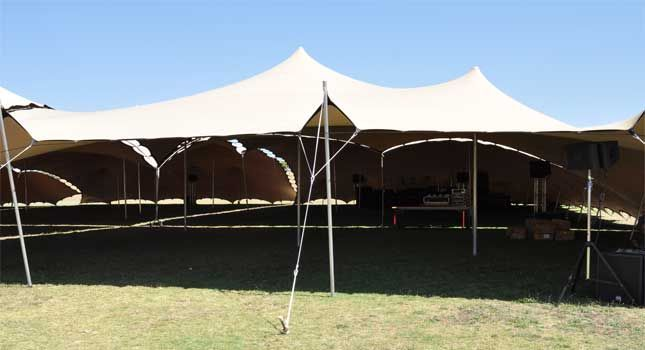 Different sized chino-coloured stretch tents linked together to form an extraordinary rig of 1 600m².