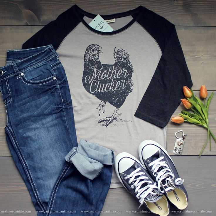"Calling all crazy chicken ladies! We love this Babe Raglan versiou of the Original Cheekys Brand ""Mother Clucker"" top. This soft black and gray raglan looks great with our Wanting More Jeans!"