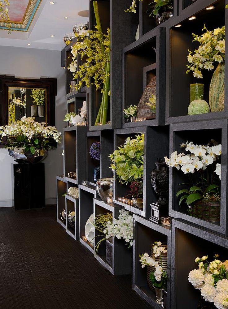 Visual merchandising. Retail store display. Floral / flower shop. Black / green.