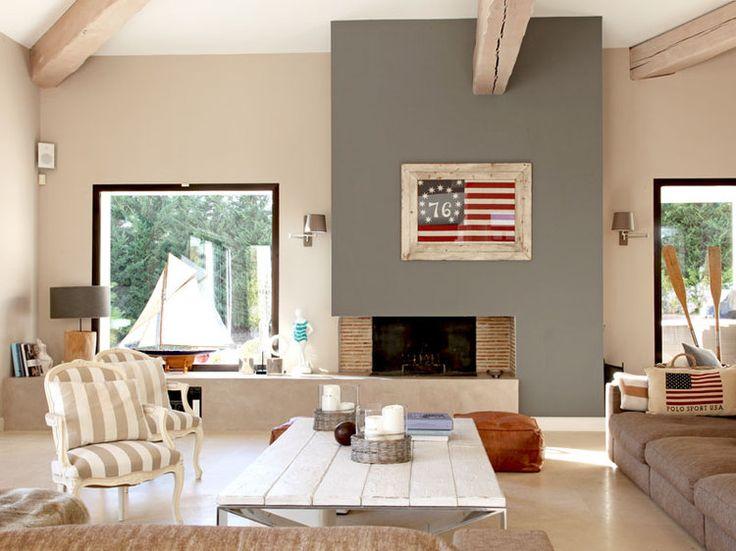La cheminée grise et en briques de brigitte