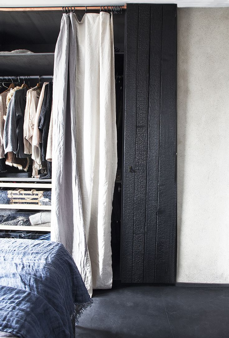Soft linene and carbonized wood. SLOW DESIGN STUDIO Photo:Filippa Tredal