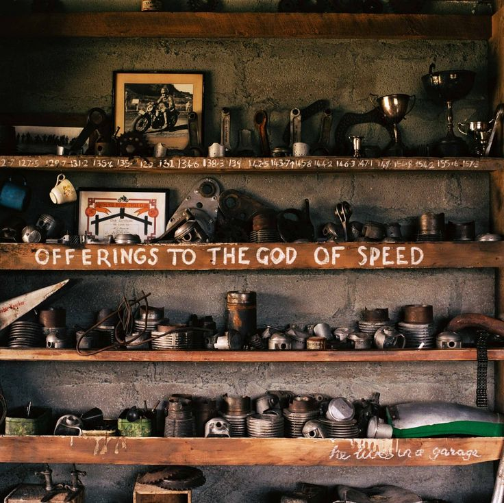 Awesome...offerings to the 'God of Speed' from Burt Munro's shop/home