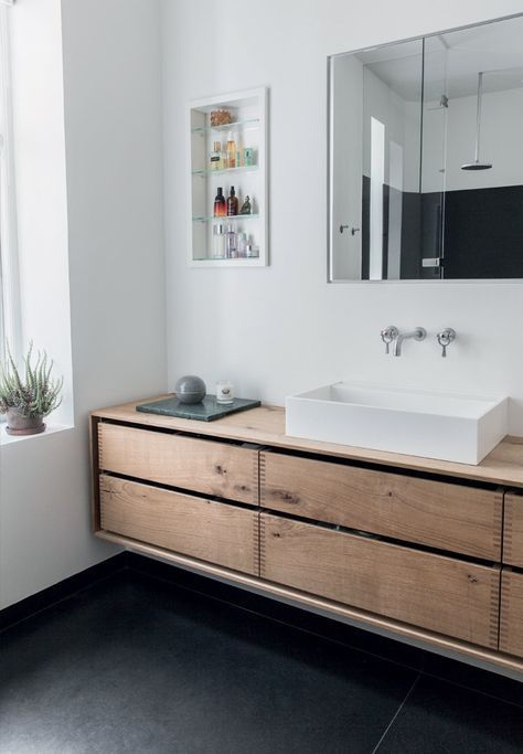 Clean bathroom with furniture made by oak planks.