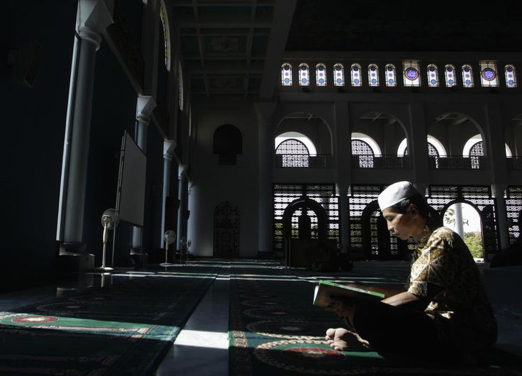 A man reads the Koran in a mosque on the first day of the holy fasting month of Ramadan in Surabaya, East Java, June 29, 2014.
