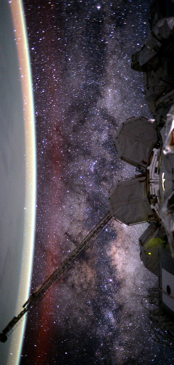 The picture was taken by Astronaut Scott Kelly on August 9, 2015, the 135th day of his one-year mission in space on the International Space Station. The Milky Way stretches the curve of Earth in the scene that also records a faint red, extended airglow. The galaxy's central bulge appears with starfields cut by dark rifts of obscuring interstellar dust. Since November 2000, people have been living continuously on the International Space Station.