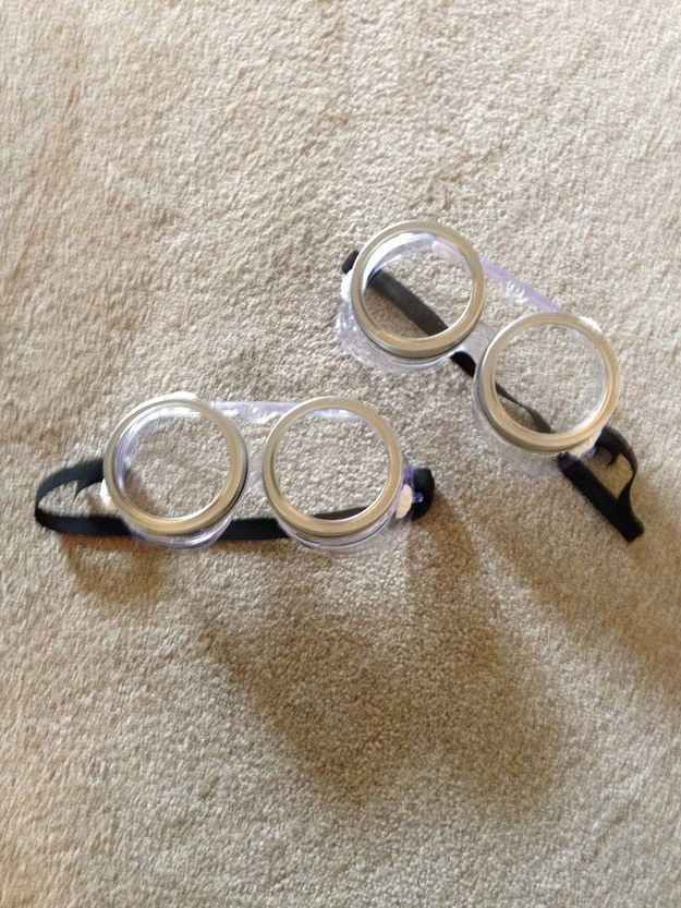 Make Minion glasses with protective goggles from the dollar store and canning jar rings. | 51 Cheap And Easy Last-Minute Halloween Costumes