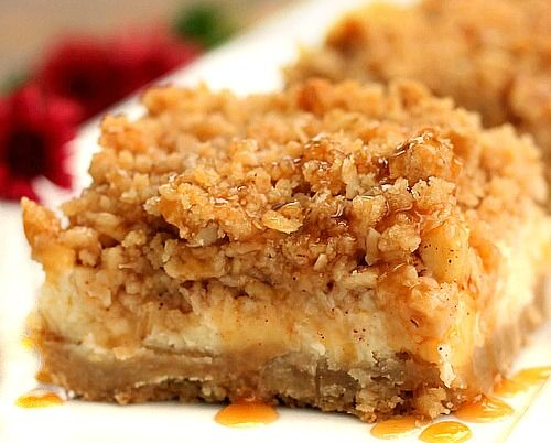Caramel Apple Cheesecake Bars Tart Granny Smith Apples layered over a cream cheese filling topped with streusel and drizzled with caramel sauce makes for an absolutely perfect treat!