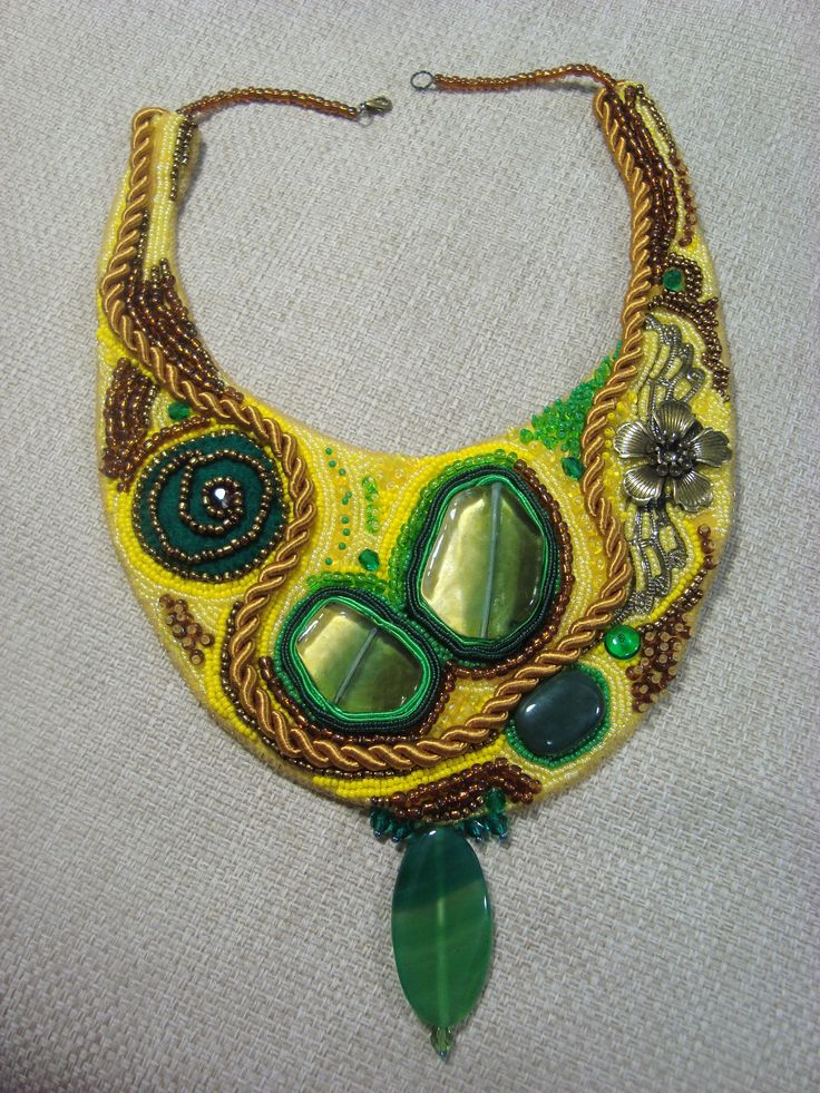Adela Petcu_ Landscape_Toho beads necklace embroidered with two large pieces of Murano glass, a leaf and an agate cabochon. It is completed with a branch of bronze, felt and silk ribbon.