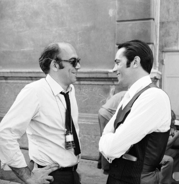 French actor Alain Delon talking with the director Jacques Deray in Marseille, on the set of the film BORSALINO, on September 29, 1969.