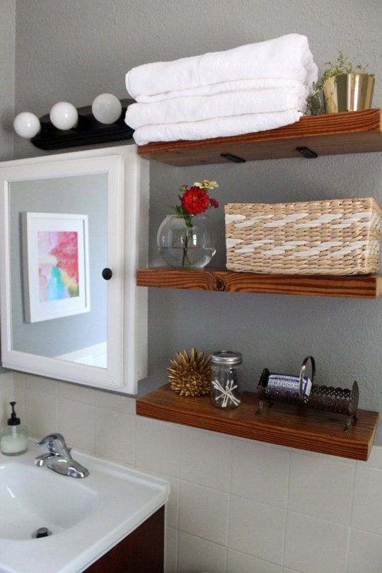 neutral bathroom with gorgeous wooden open shelves