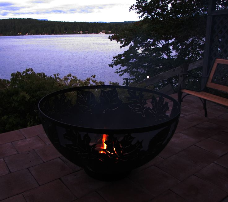 """A beautiful west coast view behind a 42"""" Autumn Leaves firebowl"""