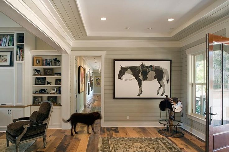 Or paint the walls a benjamin grey and the trim white as well as the ceiling. This form of wood paneling will look far suprior painted then the wall 4x8 sheet panels. That stuff was too porous and looked cheap no matter what you do with it.  Rustic Entry by Wayne Windham Architect, P.A.