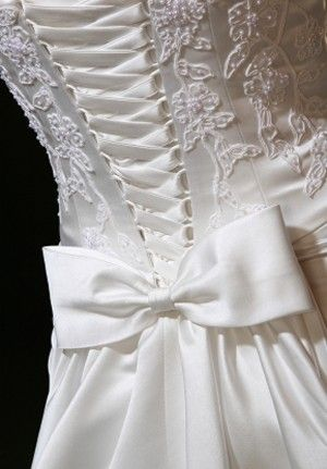 Beautiful A close up of a wedding dress with a large silk bow stock photo