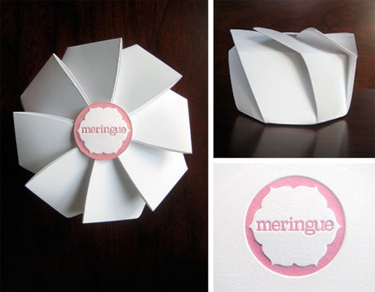 The origami-inspired cookie box emulates the folds and peaks of meringue cookies. Macaron boxes and bags frame the beauty and color of the macarons. Letterpressed tissue and seals add a pop of color and tactile quality to white and clear packaging.""