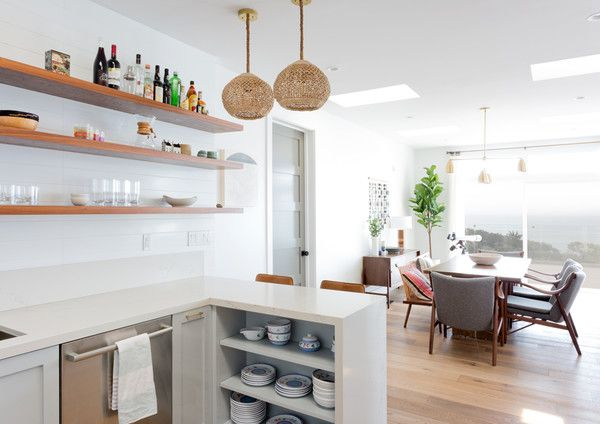 """""""The kitchen is my favorite because it's both a mix of high-low: high end appliances and specialty fixtures with IKEA boxes and Semihandmade fronts,"""" says Myers. """"I love that my clients took design risks with the lack of upper cabinets on shiplap walls, the tiled peninsula, the brass hardware.""""West Elm Chairs; Roost Pendants; Clé Tile."""