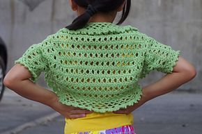 This is a free crochet pattern for kid's shrug called Aida Shrug. It has photo tutorial in each step to guide your in your crochet journey.