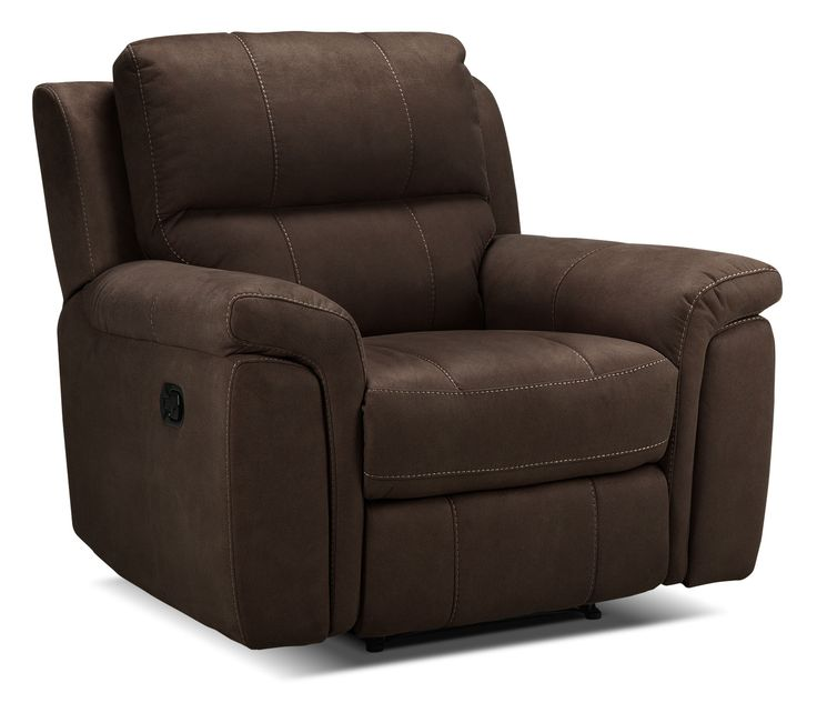 Your Own Oasis. The thick, pillowtop seat and cushy, padded armrests of the Roarke recliner in walnut are the perfect refuge from a hectic day. Sink into the plump cushions, recline back and relax your cares away. The dark brown hue is easy to accessorize, and its rich tone adds a sumptuous look. Better still, the premium Leggett & Platt reclining mechanism ensures you will enjoy lounging in this plush seat for years to come.  Special order item. Please allow approximately 12-14 weeks fo...