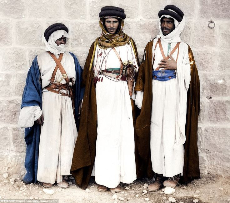 The Bedouin formed the core of the army that Lawrence of Arabia assembled during the Arab Revolt of 1916-18 against the Ottoman Empire. The tribesmen gave Arab forces under the command of local princes vital help during sieges of the imperial garrisons in Mecca and Ta'if. Pictured are three Bedouin men in traditional dress in the American Colony of Jerusalem