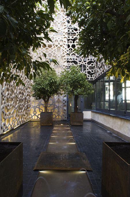 Jardim de inverno minimalista com vasos.  Fotografia: http://www.decorfacil.com