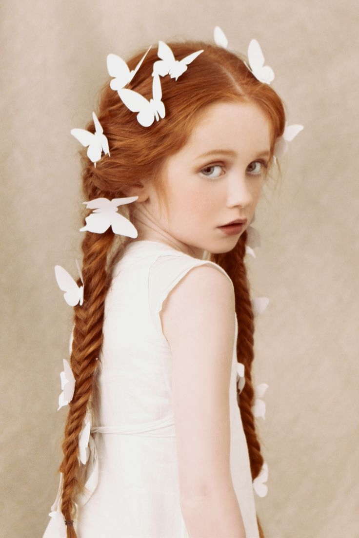 Its hard not to stare when she has butterflies in her hair.