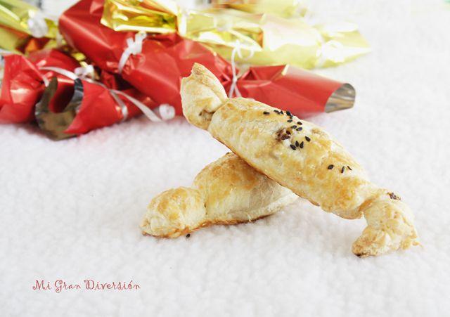 Caramelos de hojaldre rellenos de setas confitadas, brie y nueces
