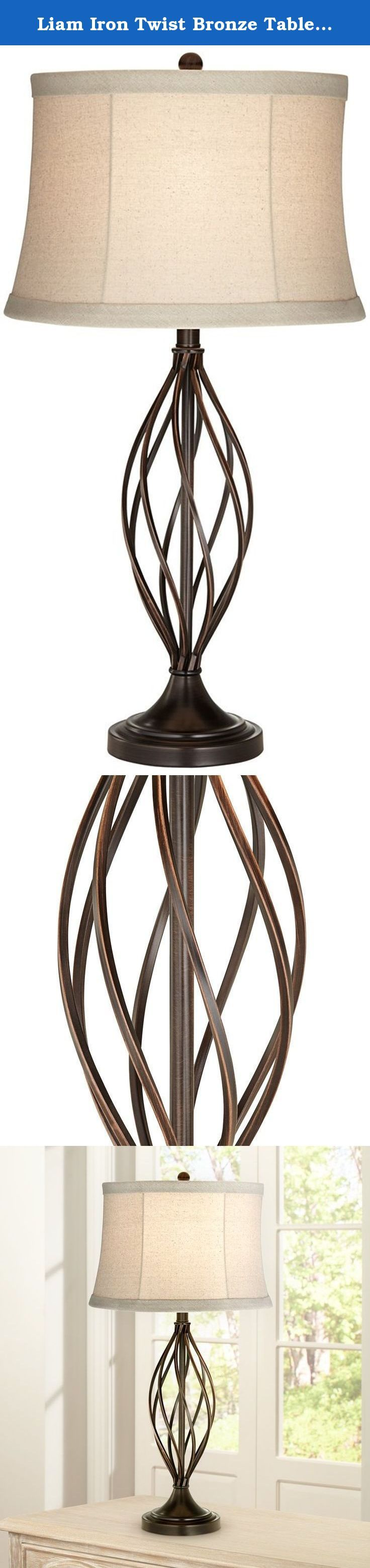 "Liam Iron Twist Bronze Table Lamp. A classic and timeless transitional table lamp style in a deep bronze finish. Constructed in iron metal material and topped with a tapered tan drum shade. Ideal for any room in your home. - Metal table lamp. - Open twist base design. - Bronze finish. - On-off switch. - Maximum 150 watt or equivalent bulb (not included). - Shade is 13"" across the top, 15"" across the bottom, 10"" on the slant. - 29 1/2"" high."