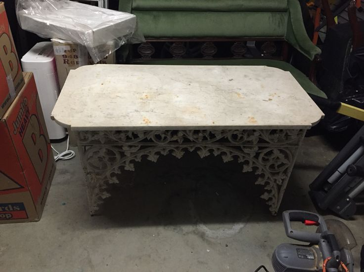 Antique marble table. Paint cast iron frame black? I have marble inside so need to be careful, but do love the table