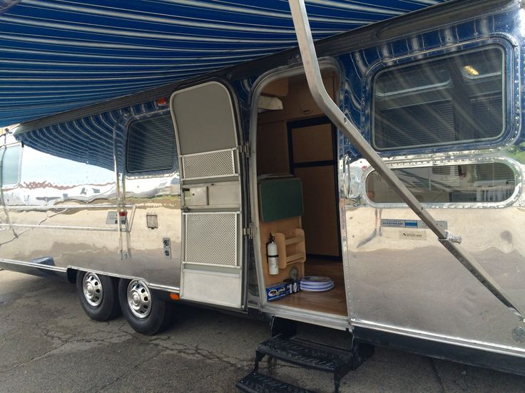 Polished Vintage Airstream Travel Trailer With New Awning And A Newly Renovated Interior Completed At Woodland