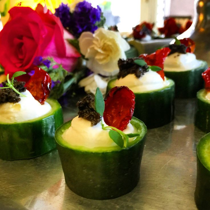 Goatcheese mousse on a cucumber, black olive tartar and oven dried tomato