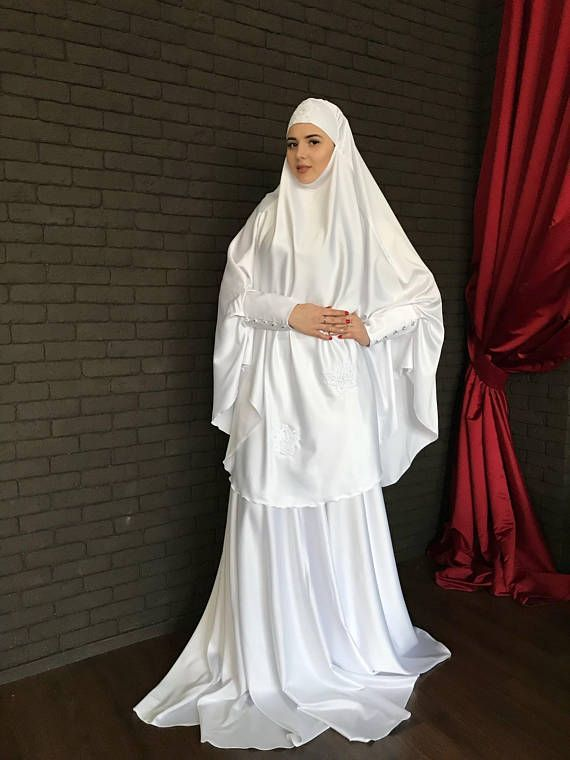 Elegant muslim suit made by soft white color silk. The costume consists of 2 parts of a skirt and a himar, a waist skirt has an elastic band, a lace trimmed with lace, high cuffs with beautiful buttons. On the photo umbrella style skirt, but at variations we also add cheaper variants