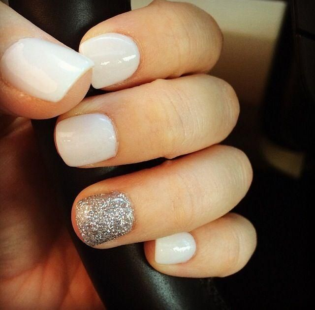 White and glitter accent nail.