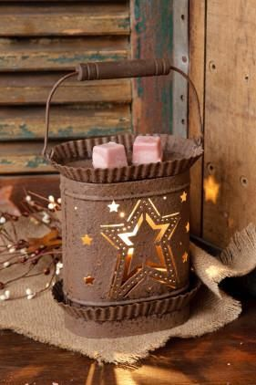 "The Electric Wax Warmer - Rustic Star Design, makes beautiful lighting and a wonderful scent accessory. Rusty Brown in color, made of metal and comes included with a 25W Bulb. 6"" W x 7"" H x 4"" D"